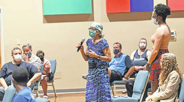 Jacqueline Tyre makes a point during a Town Hall Meeting on Police Reform at The Impact Center on Thursday. Richard Parrish | The Lima News