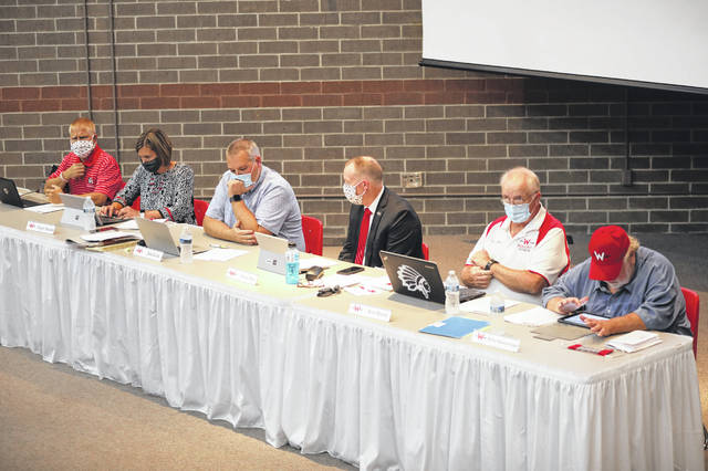 The Wapakoneta school board meet at Wapakoneta High School on Tuesday evening. Seven people were allowed to present their opinions to the board about a possible mascot change.