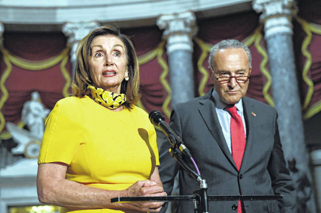 House Speaker Nancy Pelosi, left, speaks as she stands next to Senate Minority Leader Sen. Chuck Schumer on Capitol Hill in Washington on Monday, Aug. 3, 2020. Schumer and Pelosi met earlier with Treasury Secretary Steven Mnuchin and White House Chief of Staff Mark Meadows as they continue to negotiate a coronavirus relief package.