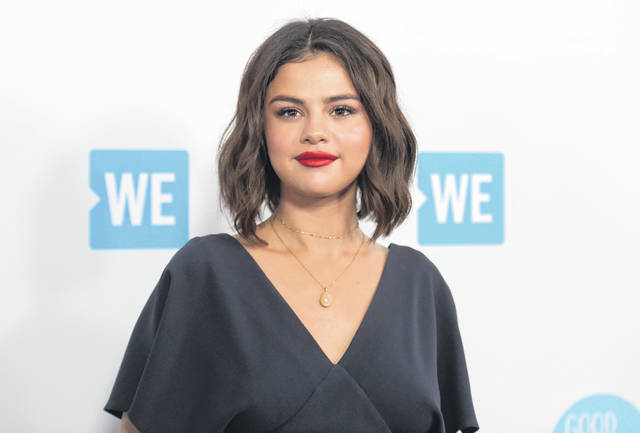 "Selena Gomez arrives at WE Day California on April 19, 2018, in Inglewood, Calif. Gomez slices and dices in ""Selena + Chef,"" debuting Aug. 13 on the new HBO Max streaming service. The 10-episode series was shot in the kitchen of Gomez's new Los Angeles-area house. Her grandparents and two friends, who have been quarantining with her, serve as taste testers."