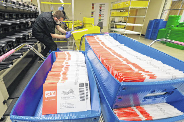 Vote-by-mail ballots are shown in sorting trays Wednesday at the King County Elections headquarters in Renton, Wash., south of Seattle. Never in U.S. history will so many people exercise the right on which their democracy hinges by marking a ballot at home.