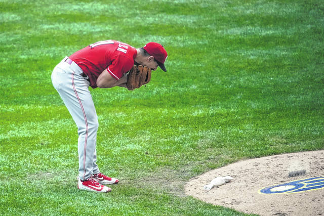 Cincinnati Reds relief pitcher Michael Lorenzen yells into his glove after giving up his second bases loaded walk during the sixth inning of a baseball game against the Milwaukee Brewers Sunday, Aug. 9, 2020, in Milwaukee. (AP Photo/Morry Gash)