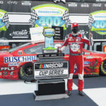 Harvick holds off Hamlin for Michigan sweep