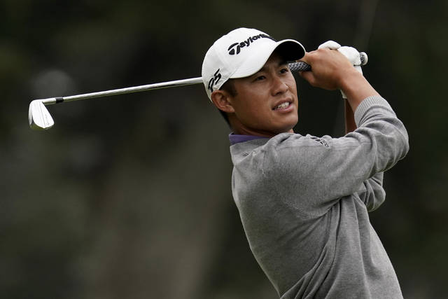 Collin Morikawa watches his tee shot on the third hole during the final round of the PGA Championship golf tournament at TPC Harding Park Sunday, Aug. 9, 2020, in San Francisco. (AP Photo/Jeff Chiu)