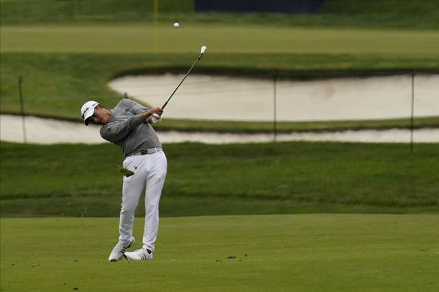 Collin Morikawa hits from the fairway on the second hole during the final round of the PGA Championship golf tournament at TPC Harding Park Sunday, Aug. 9, 2020, in San Francisco. (AP Photo/Jeff Chiu)