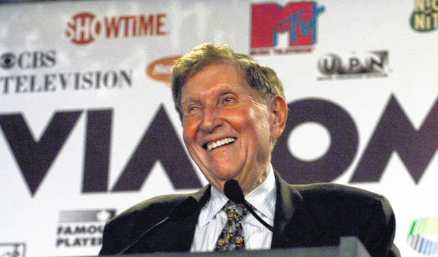 Viacom Chairman Sumner Redstone smiles during the announcement of a merger between CBS and Viacom in New York on Sept. 7, 1999. Redstone, the strong-willed media mogul whose public disputes with family members and subordinates made him a feared operator in Hollywood, died Wednesday.