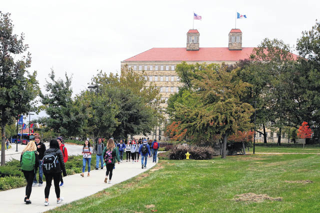 Students walk in front of Fraser Hall on the University of Kansas campus in Lawrence, Kan., in October. Student loan borrowers with federal debt won't see a bill until January 2021. That means three extra months of paused payments tacked onto the original six months made possible by the coronavirus relief package.