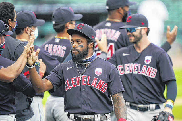 Cleveland Indians center fielder Delino DeShields greets teammates after their 8-5 over the Detroit Tigers in a baseball game, Sunday, Aug. 16, 2020, in Detroit. (AP Photo/Carlos Osorio)