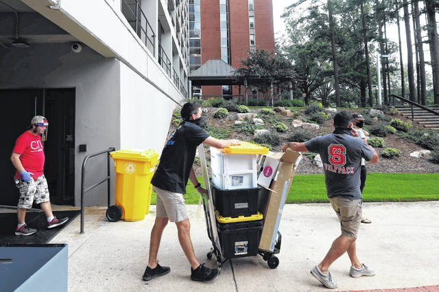 College students begin moving in for the fall semester July 31 at N.C. State University in Raleigh, N.C. Colleges are eager to share their reopening plans as they encourage students to return to campus. But fewer of them are talking about the elephant in the room: What happens if they need to shut down again.