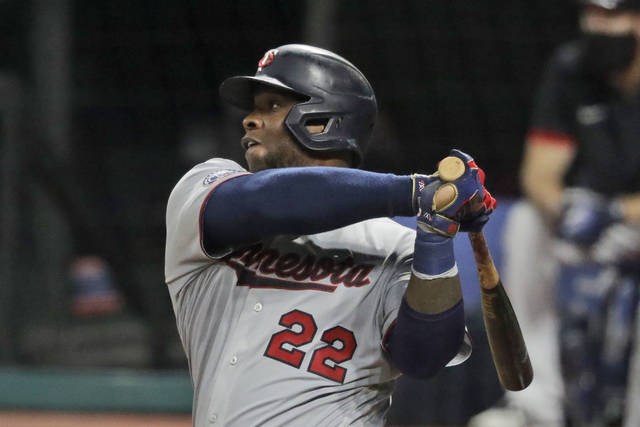 Minnesota Twins' Miguel Sano hits a two-run home run in the sixth inning in a baseball game against the Cleveland Indians, Monday, Aug. 24, 2020, in Cleveland. (AP Photo/Tony Dejak)