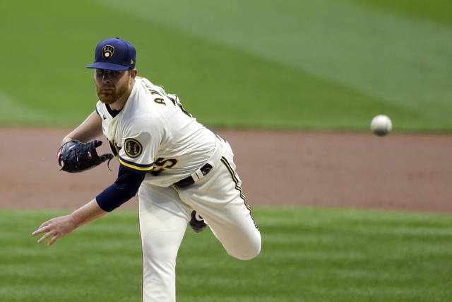Milwaukee Brewers' Brett Anderson pitches during the first inning of a baseball game against the Cincinnati Reds, Monday, Aug. 24, 2020, in Milwaukee. (AP Photo/Aaron Gash)