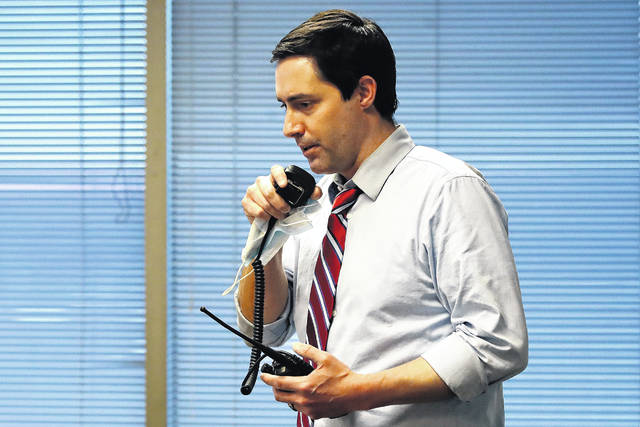 FILE - Ohio Secretary of State Frank LaRose, overseeing the Election Night Reporting Center in Columbus, Ohio, calls for the closing of the polls in the Ohio primary election, Tuesday, April 28, 2020.
