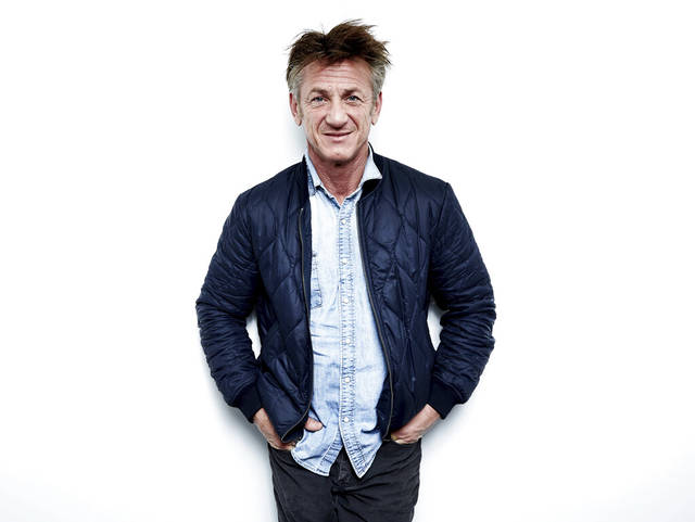"Sean Penn poses for a portrait to promote his novel ""Bob Honey Who Just Do Stuff"" on March 27, 2018, in New York. Penn, who turns 60 on Aug. 17, will be a part of an online reading of ""Fast Times at Ridgemont High."" (Photo by Taylor Jewell/Invision/AP, File)"