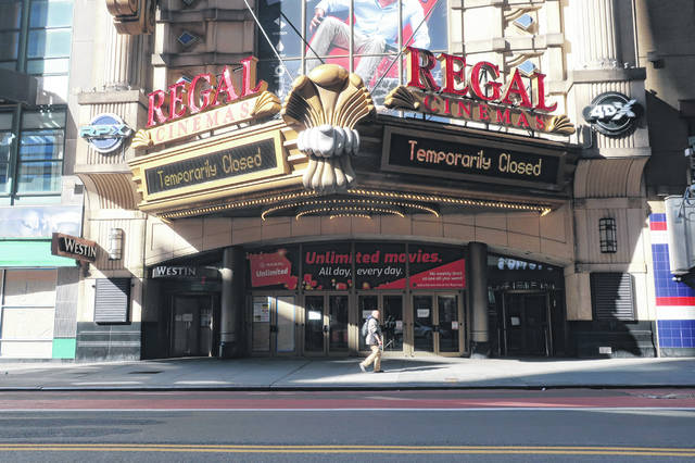 FILE - A Regal Cinemas movie theater is temporarily closed during the coronavirus pandemic in New York on May 5, 2020. Regal movie theaters have been closed for almost five months in the U.S. due to the coronavirus pandemic, but they are gearing up to open on Aug. 21.