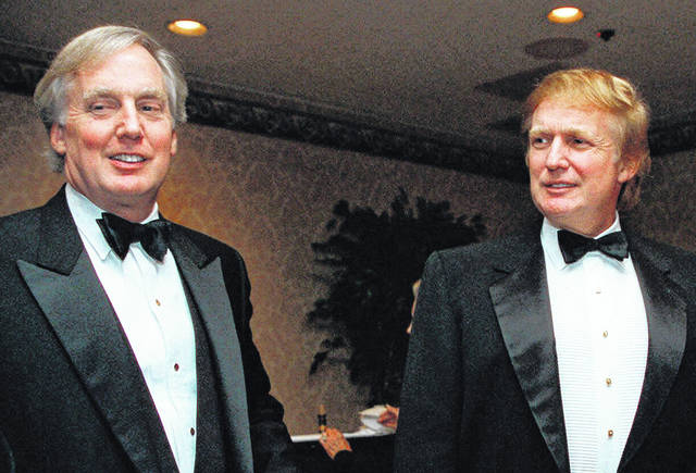 FILE - In this Nov. 3, 1999, file photo, Robert Trump, left, joins then real estate developer and presidential hopeful Donald Trump at an event in New York. President Donald Trump's younger brother, Robert Trump, a businessman known for an even keel that seemed almost incompatible with the family name, died Saturday night, Aug. 15, 2020, after being hospitalized in New York, the president said in a statement. He was 71. The president visited his brother at a New York City hospital Friday after White House officials said Robert Trump had become seriously ill.