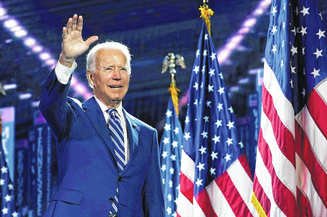 Democratic presidential candidate Joe Biden stands on stage after Democratic vice presidential candidate Sen. Kamala Harris, D-Calif., accepted his party's nomination for the presidency Thursday night.