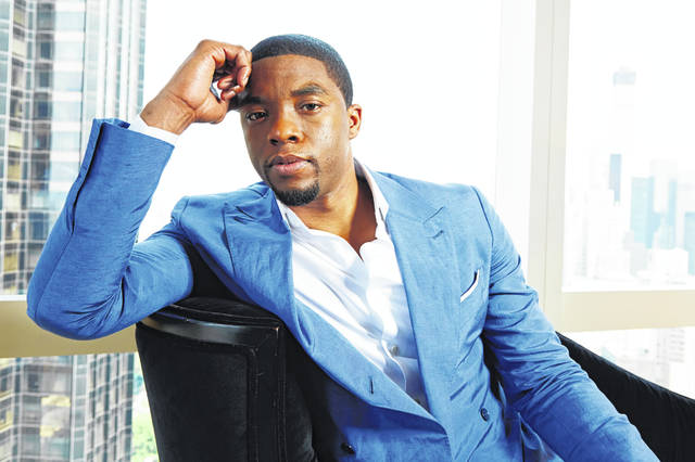 FILE - This July 21, 2014 file photo shows actor Chadwick Boseman posing for a portrait in New York. Boseman, who played Black icons Jackie Robinson and James Brown before finding fame as the regal Black Panther in the Marvel cinematic universe, has died of cancer. His representative says Boseman died Friday, Aug. 28, 2020 in Los Angeles after a four-year battle with colon cancer. He was 43.