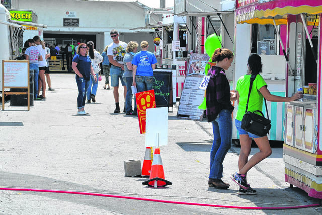 Some people refused to wear face coverings at the Auglaize County Fair, Wednesday.