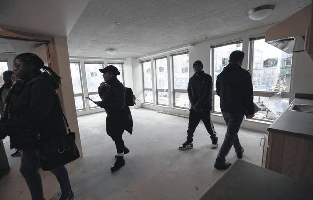 People who have been selected to move into Jackson Heights, a new affordable housing project meant to bring displaced Central District residents back to the Seattle neighborhood, tour the building which is nearly complete on Feb. 1.