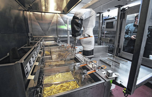 Flippy the robot demonstrates its ability to man a fry station at Miso Robotics on Jan. 28 in Pasadena, California. The coronavirus pandemic sped up interest in robotics and automation in many types of work.