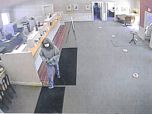 """The bank robbery suspect is a white male, between 6 foot and 6-foot-2 and 180 to 200 pounds. Anyone with information should call the Wapakoneta Police Department at at <a href=""""tel:419-738-2222"""" target=""""_blank"""" title=""""419-738-2222"""">419-738-2222</a>.."""