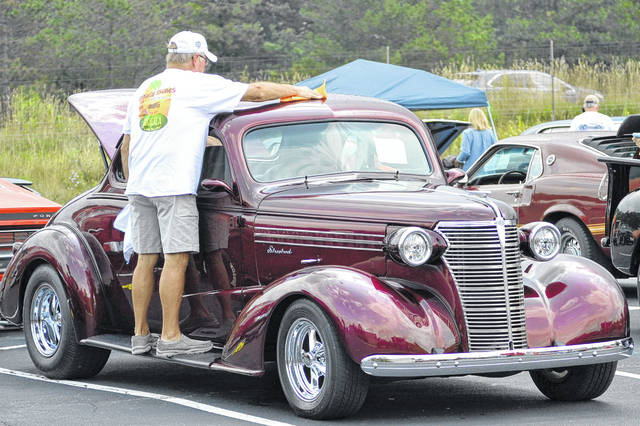 Dave Dingledine sines up his 1938 Chevy Coupe at the Midwest Shooting Center on Sunday.