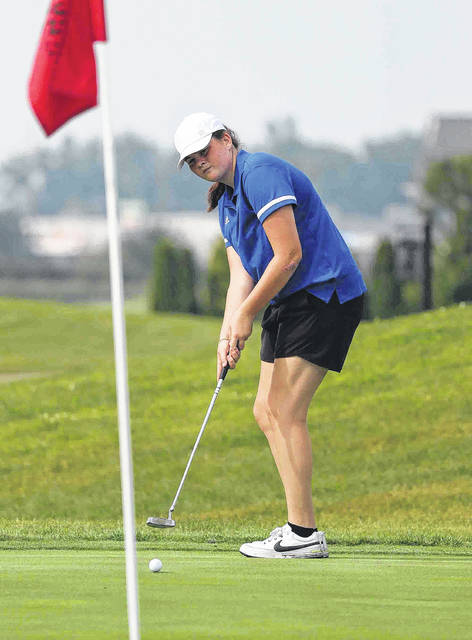 St. Marys' Eva Youngs watches her putt during Friday's Celina Invitational at Celina Lynx Golf Club.