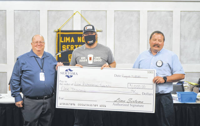 Lima Astronomical Society Vice President Michael Ritchie (left) receives a $1,000 donation on behalf of the society from the Lima Noon Sertoma Club. The check is being presented by Sertoma Club President Adam Rector (middle) and Board Chairman Ty Shelby (right).