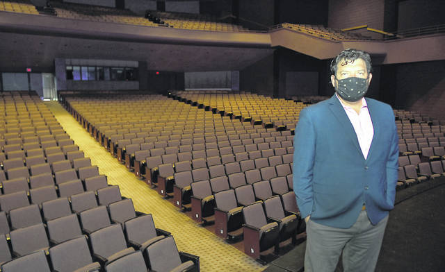 "Abe Ambroza, the CEO of Veterans Memorial Civic Center in Lima, stands in the empty theater Friday. ""The Civic Center is in a pretty desperate spot right now,"" Ambroza said."