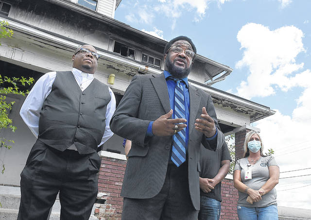 Lima City 6th Ward Councilman Derry Glenn addresses the media during a press conference to raise money for local fire victims on Wednesday. The tragic death of a 14-year-old killed in the arson fire has left his mother devastated and facing the cost of a funeral. On the left, is Rev. Calvin Montgomery  who will handle donations for the fire victims family. Craig J. Orosz | The Lima News
