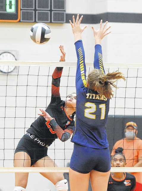 Elida's Kylie Vorhees hits a spike against Ottawa-Glandorf's Katie Kaufman during Thursday night's match at Elida.