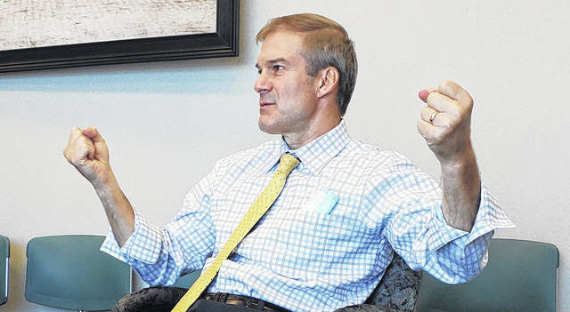 U.S. Rep. Jim Jordan, R-Urbana, illustrates a point about opposing factions during a visit to The Lima News on Wednesday.
