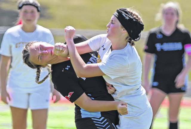Lima Central Catholic's Madalena Knotts, left, and Ottoville's Alexis Sanders collide during Saturday's match at Spartan Stadium. See more match photos at LimaScores.com.