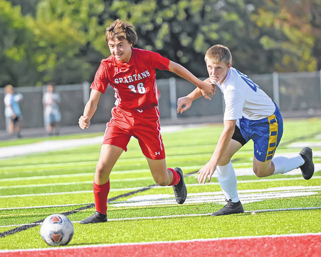 Lima Senior's Keegan Halliday dribbles ahead of Lincolnview's Austin Bochrath during Tuesday's match at Spartan Stadium.