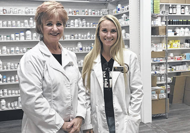 Registered pharmacist Denise May celebrates one year of business at Leahy Family Pharmacy, a family owned pharmacy located at 825 S. Cable Road. Pictured are Denise May and Gillian Hammer, an Ohio Northern University pharmacy student.