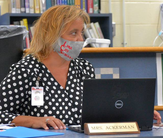Jill Ackerman, superintendent of Lima schools, explains the new mask policy to school board members in a meeting Monday night.