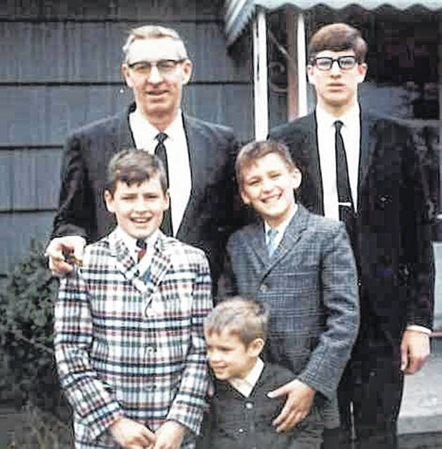 Bob Linneman appears in a family photo with his sons. Pictured are, top right, Peter, and front row from left, Matt, Andy and Doug.