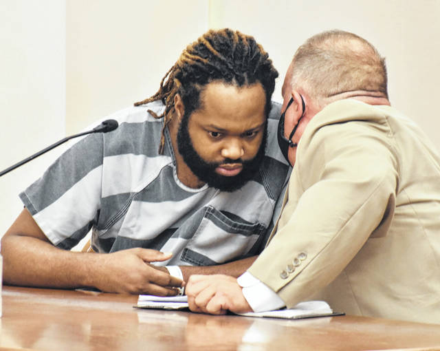 Marquez Pritchett, charged with murder in the 2017 shooting death of Lima resident Shannon Scott, confers with his attorney, Brad Hubbell, during an appearance Monday in Allen County Common Pleas Court. Following a psychological evaluation, Pritchett was deemed competent to stand trial on Oct 27.