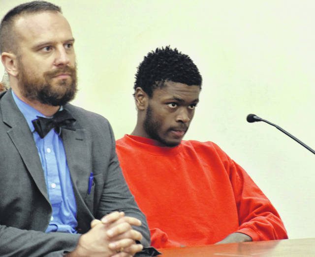 Carroll Creighton, left, withdrew as the attorney of record for 17-year-old Na'zier Howard on Wednesday. Howard is one of two juveniles charged as adults in the January robberies of Little Caesar's and Hermie's Party Shop in Lima.