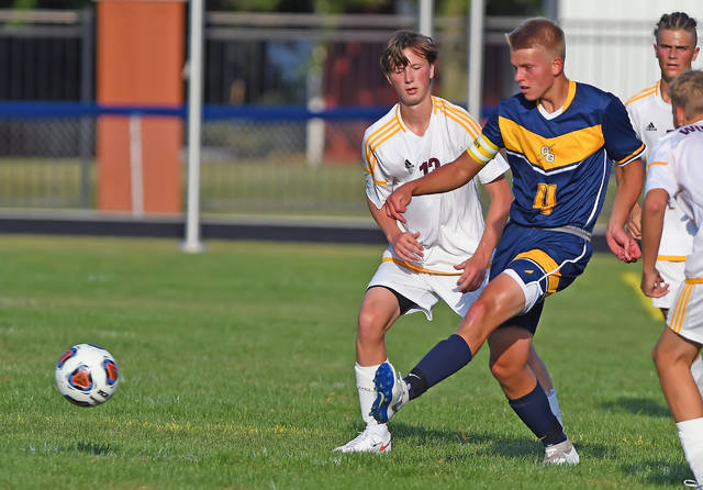 Ottawa-Glandorf's Jaden Lehman passes against Kalida's Drew Fersch during Friday night's match in Ottawa. See more match photos at LimaScores.com.