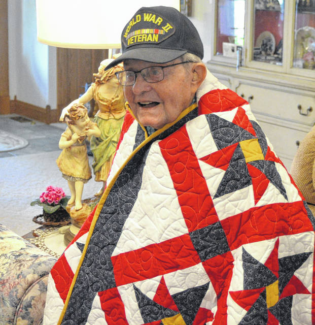 Miles Hefner, 98, was awarded a Quilt of Valor in a ceremony Sunday.