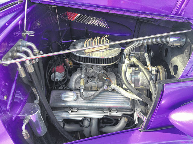 """Duke Mauk, of Lima, owns this 1937 Chevy Coupe, known as the """"Purple Lady."""" It has an automatic transmission."""