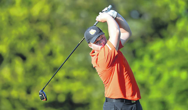 Elida's Carson Harmon watches his tee shot on the first hole during Thursday's Rob Contini Memorial Lima City Invitational at Colonial Golfers Club in Harrod.