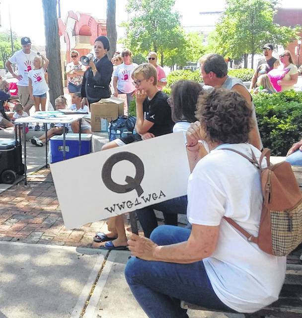 Followers of QAnon were represented at Saturday's Save The Children Walk in Lima's Town Square.
