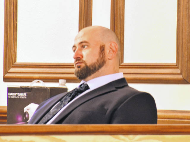 Scott Seitz listened to testimony Monday as his trial on charges of aggravated robbery and felonious assault got underway in Allen County Common Pleas Court.