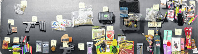 Items seized during the search of a Delphos-area property included suspected marijuana, suspected LSD, suspected psychedelic mushrooms, THC vapes and cartridges, edible THC products, suspected drug proceeds and two handguns with loaded magazines.