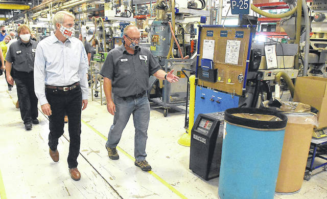 US Sen. Rob Portman, left, tours World Class Plastics in Russells Point with company vice president Scott Wisniewski on Monday. The company has shifted some of its production to face masks and face shields.