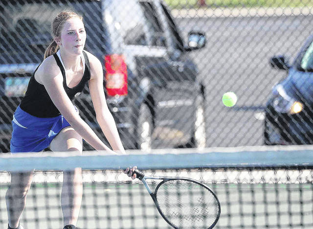 St. Marys' Grace Dodson chases a shot during Thursday's home match against Shawnee.
