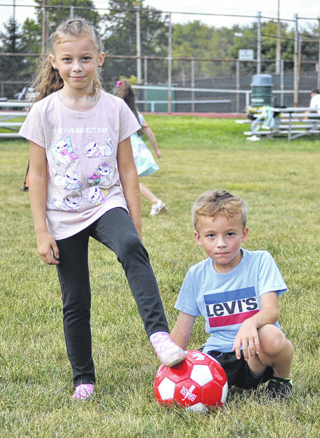 Ava and Shawn Cook enjoy playing soccer.