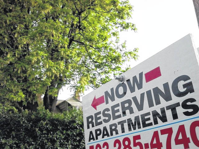 A sign advertises apartments for rent in North Portland, Oregon. Historically low interest rates are complicating the numbers that come out of online calculators meant to help you decide whether you should rent or buy.